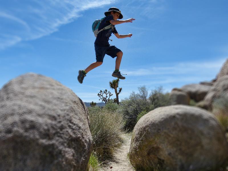 Simon jumping rocks in Joshua Tree National Park.