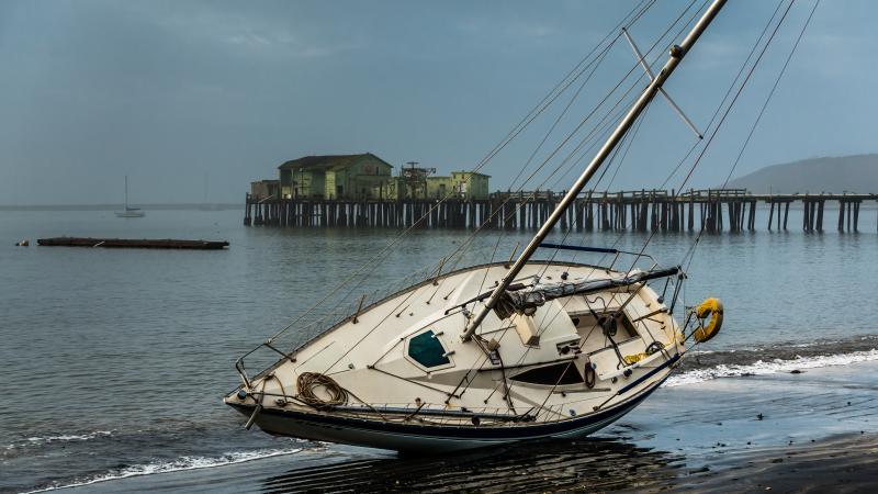Beached yacht at Half Moon Bay