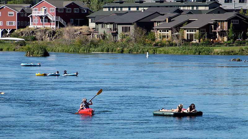 Paddlers on the River Deschutes in downtown Bend.