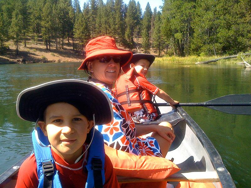 Simon, Kari, and Henry paddling on the River Deschutes