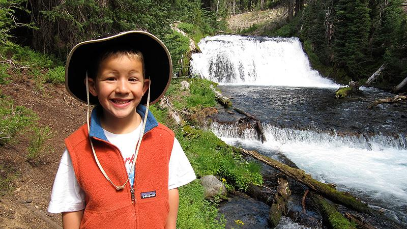 Henry checking out waterfalls along Green Lakes hike
