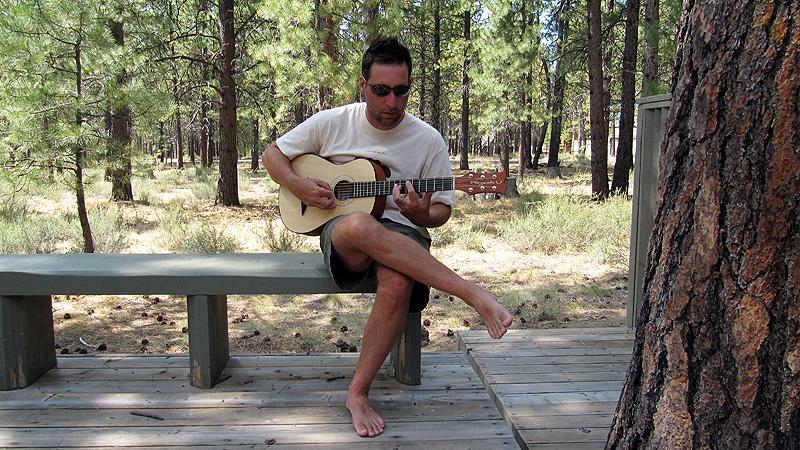 Jack lounging with Simon's mini-guitar