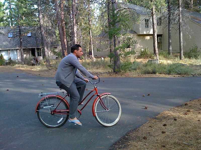 Jack lounging on a cruiser bike.