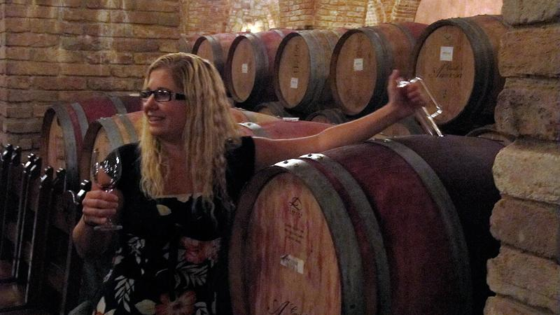 Barrel tasting deep in the dungeons of Castello di Amorosa.