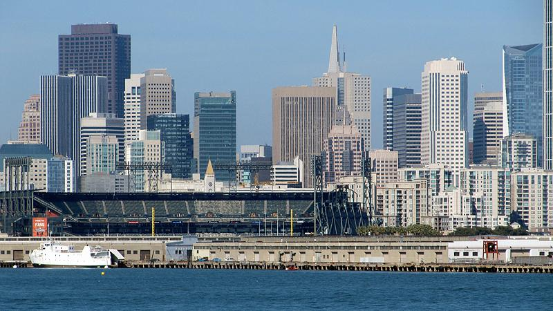 AT&T Park with cityscape background.