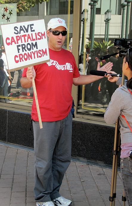 """That's me getting interviewed at Occupy Oakland. """"Save Capitalism from Cronyism"""""""