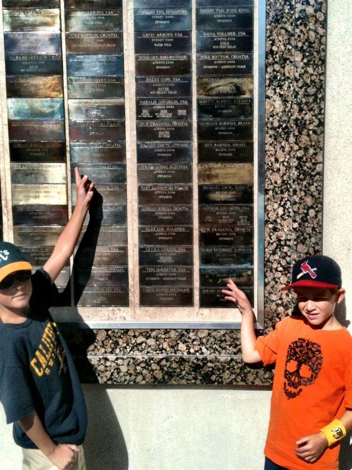 Simon and Henry spotting their swim coaches on the olympian wall at Cal.