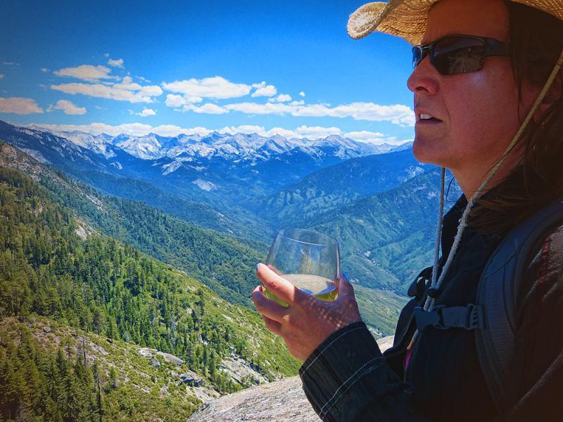 Kari enjoying some Climbers Pouch Chardonnay atop Mora Rock.