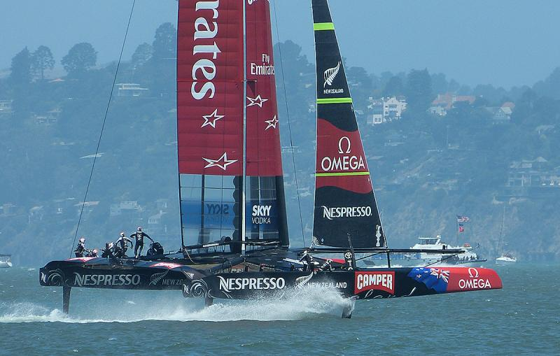 Emirates Team New Zealand foiling down wind.