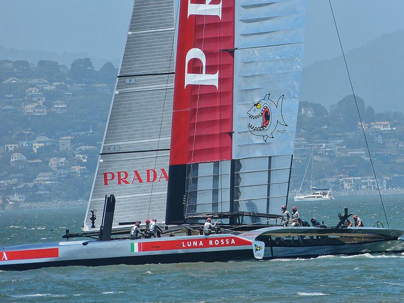 Luna Rossa - The crew wears shiny silver outfits.