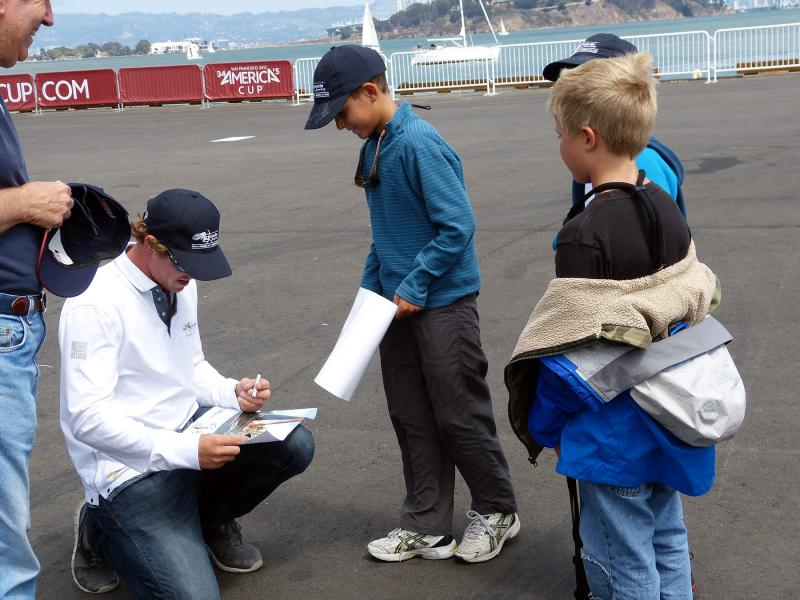 Our sailors getting autographs from Nathan Outteridge at America's Cup Park.