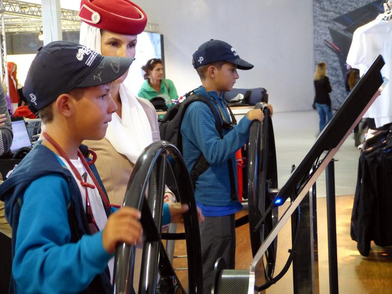 Our sailors putting in some virtual regatta time at the Fly Emirates booth.