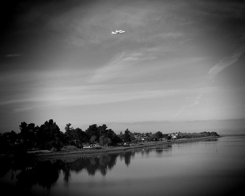 Black and white version of space shuttle flying over Alameda.