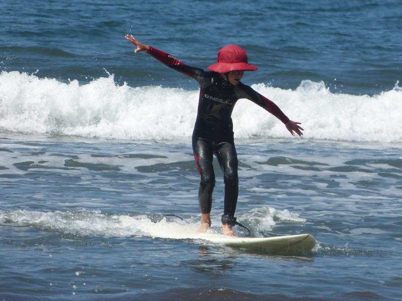 Henry surfing at Stinson.