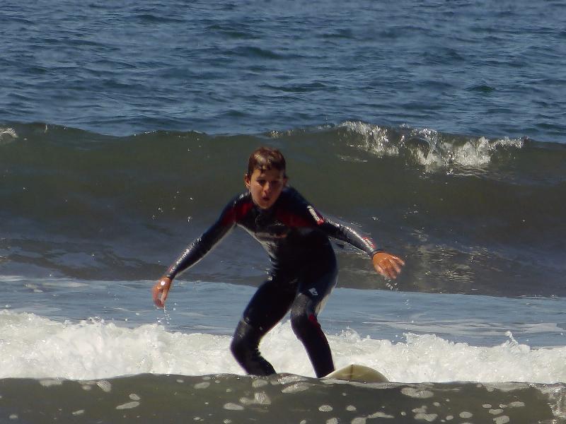 Simon surfing at Stinson.