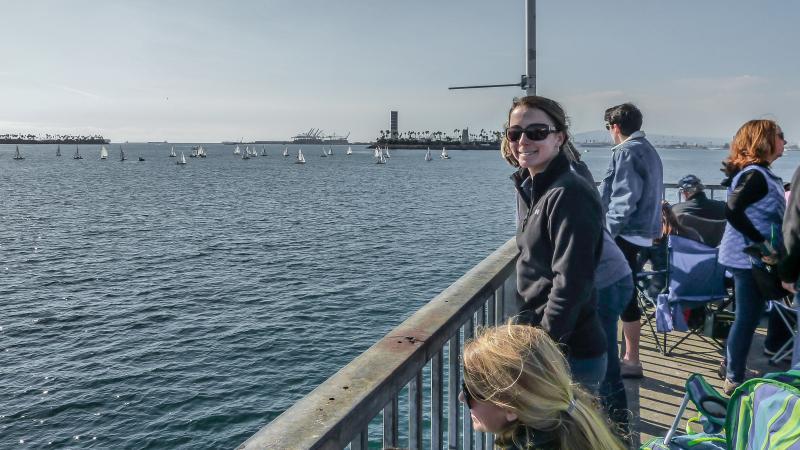Coach Hannah watching from the Long Beach pier.