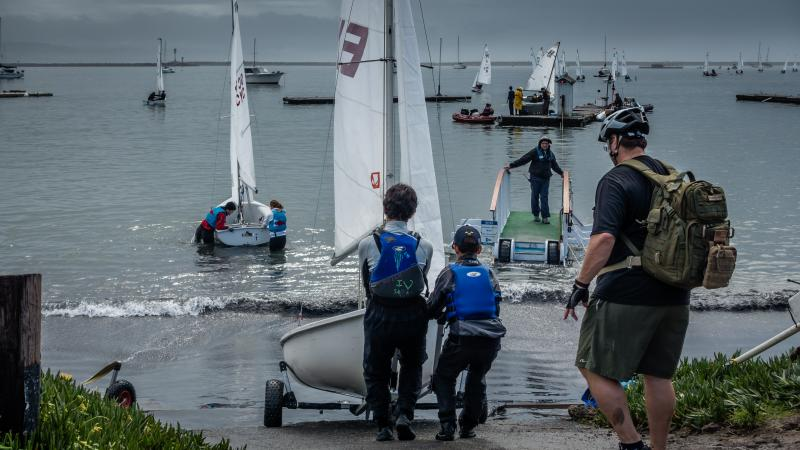 Simon and Liam - last to launch with a leaky boat. They wound up winning the regatta.