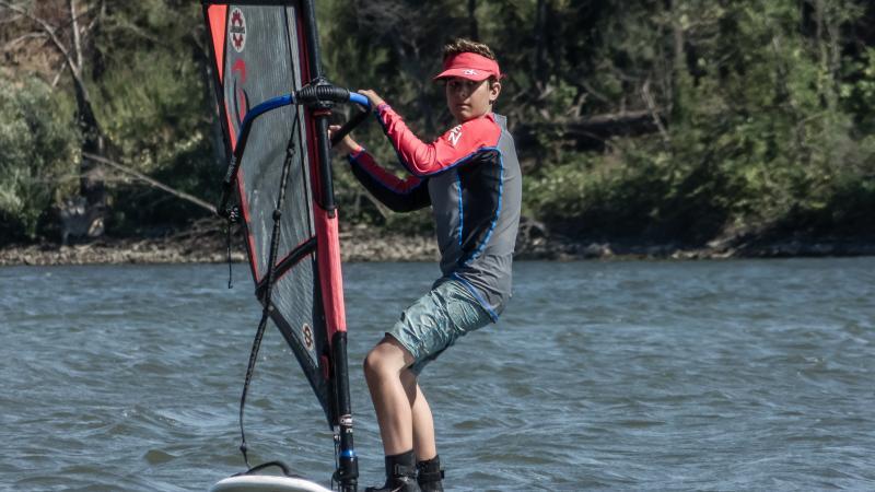 Simon windsurfing.