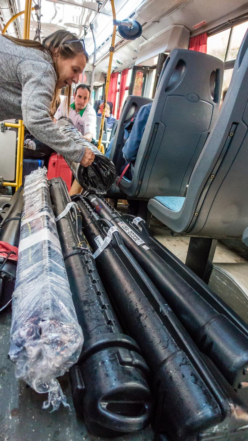 On the bus to the border with Team Chile. Lots of sail tubes.