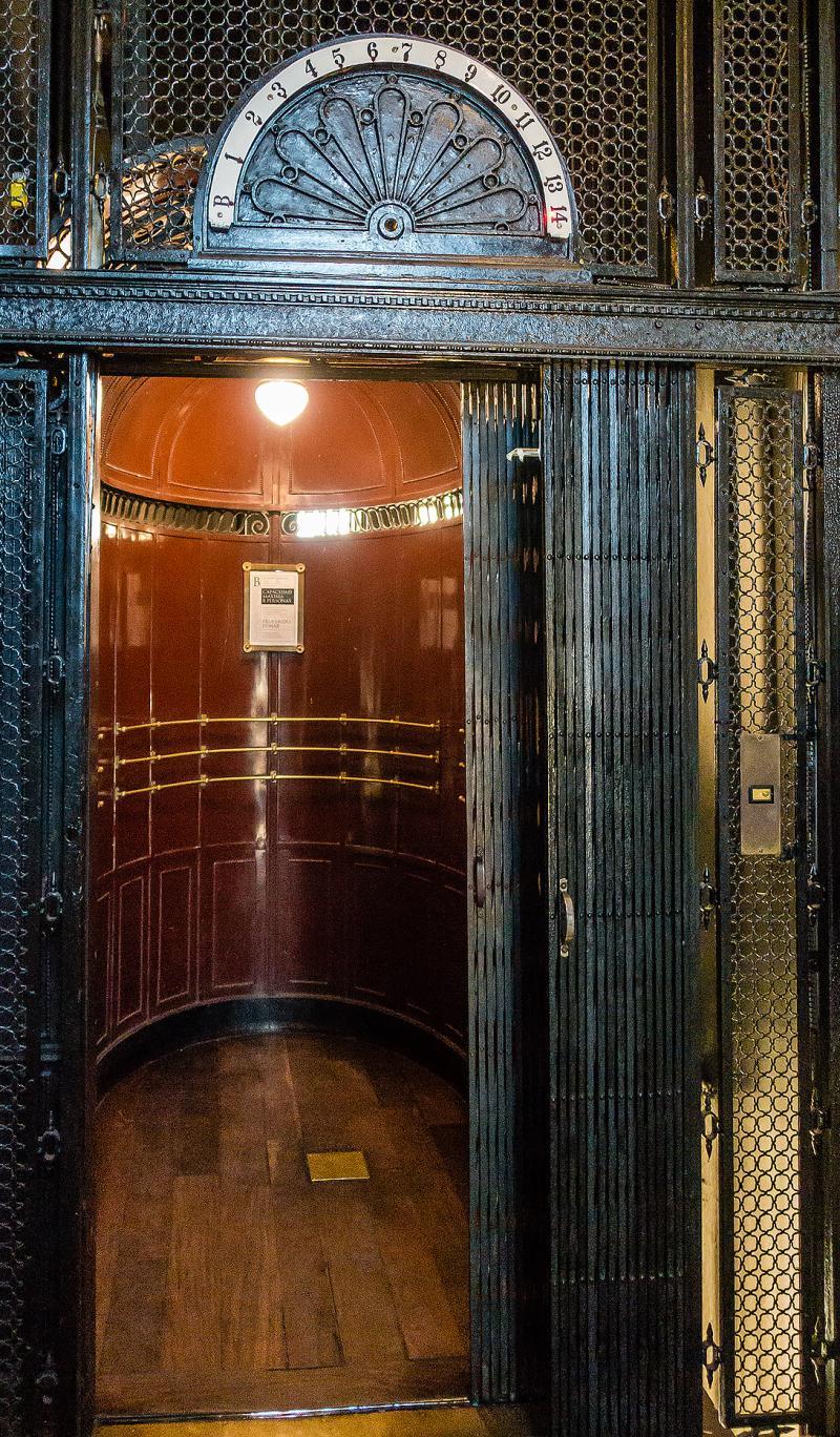 Heading up inside Palacio Barolo in art deco elevator.