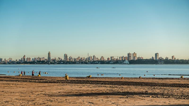 Encarnacion's giant river beach with Posadas across the Parana River. This beach turns into Fort Lauderdale during Carnival.