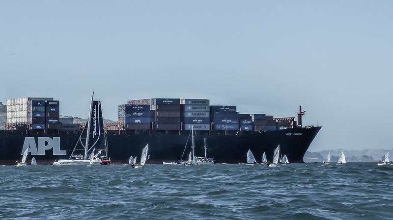 Typical of freighters to cruise through or very near the race course.