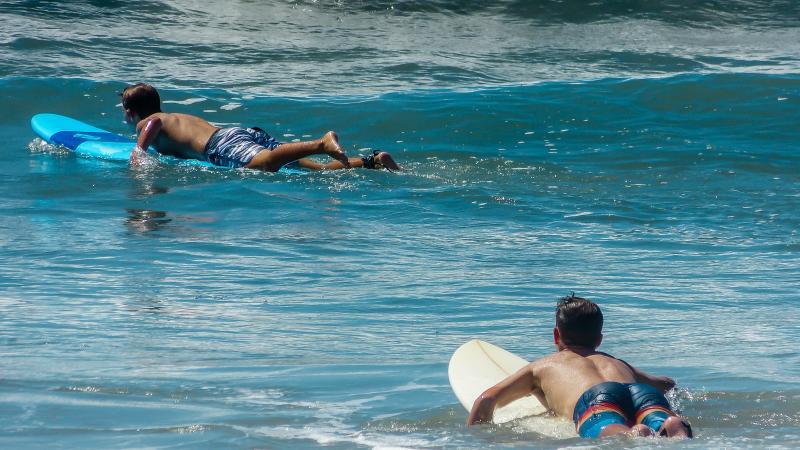 Surfing next to the Manhattan Beach pier.