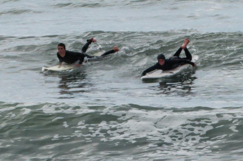 Simon and Henry surfing at Pacifica