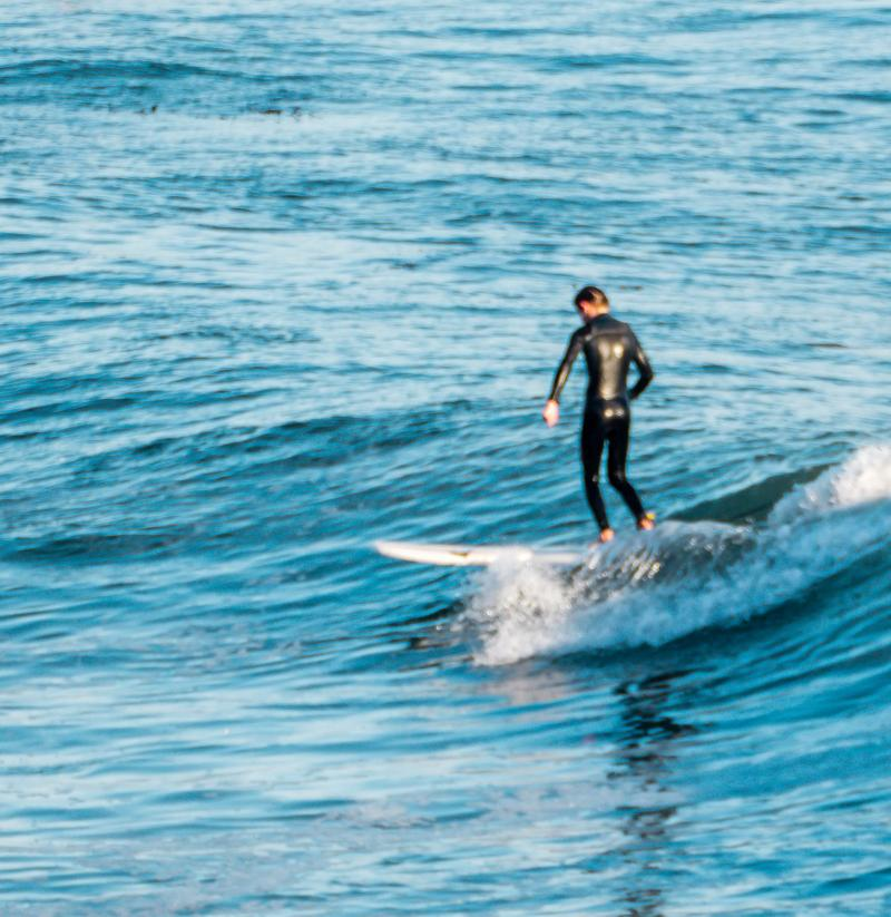 Henry surfing The Hook at Santa Cruz.
