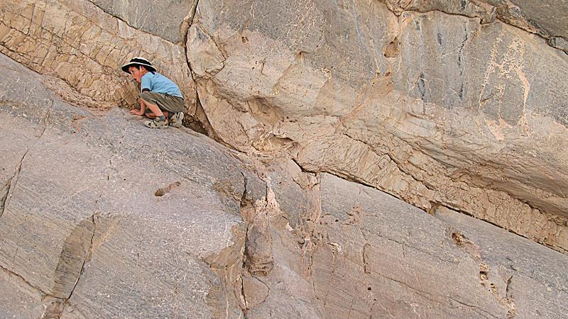 Henry doing a little rock climbing in Titus Canyon